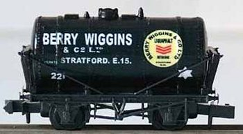 "Berry Wiggins ultimately operated a large fleet of both Class A ( highly inflammable ) and Class B ( less volatile liquids including bitumen ) tank wagons obtained over a long period of time from builders such as Charles Roberts of Wakefield and The Cambrian Wagon Company. Many Berry Wiggins operated railway wagons were also later leased from British Railway Traffic and Electric Company Limited (BRT & E) of 13 Grosvenor Crescent, London. Historians usually accept that these wagons were painted black and definitely had white lettering in a range of formats. The circular plates on the sides were pale yellow with ( in many cases but excluding wagons 28 and 82 ) red sergeant's stripes and in many cases ( including Charles Roberts built wagon 96 ) also included the words ""British Made"" and ""Liquaphalt"" - Berry Wiggin's own trade name for liquid ashphalt, or bitumen. Next to the circular plate, the single contrasting star denoted clearance for the wagon to travel at up to 35 miles per hour."