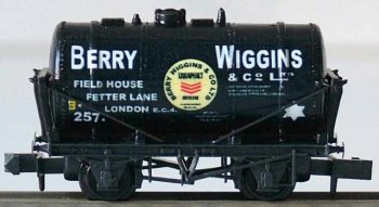 The London offices of Berry Wiggins were in Stratford E15 and Field House, Fetter Lane EC4 and the company produced bitumen from a plant at Sharnel Street on the Isle of Grain as early as 1924. Although it was not until 1949 that their cylindrical tank wagons began to be shunted on the siding behind the goods shed at Whimsey the whole site belonged to Berry Wiggins soon afterward. The asbestos lagged tank wagons would then be heated ( as described in Gloucestershire's Chemical Romance ) to offload the otherwise solid bitumen either to storage tanks or directly to road tankers for onward distribution around west Gloucestershire and Herefordshire. Six or seven loaded wagons would arrive at Whimsey every day - and a corresponding number leave empty - until the depot closed along with the branch from Newnham - which had once run through to Mitcheldean Road between Gloucester and Ross on Wye - in 1967. Also seen at Berry Wiggin's Whimsey depot were South Eastern Gas Board tank wagons with red oxide barrels, white lettering and black solebars and running gear.
