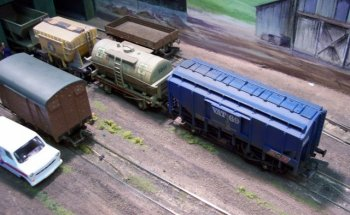 A further refinement of the Class A two axle format is seen here on Mike Briggs & Nick Barnett's 00 gauge Marcroft layout displayed at the Cheltenham GWR Modeller's Group Exhibition in aid of CLIC Sargeant in April 2007. Seen here in the company of wagons built to carry grain, cement and coal, the British Petroleum tank wagon carries its yellow, white and green trademark on a grey background and has its two midships ladders curved inside the loading gauge and only reaching down to the solebars.