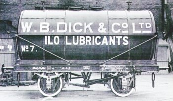 "Cylindrical tank wagon 7 in the overall black of Dick Lubricants was outshopped from Charles Roberts of Wakefield in June 1930. The 17' 41/2"" by 6' 41/2"" diameter barrel - split into two equal compartments for the carriage of different load types in the same journey - had horizontal tie bars above the longitudonal cradle but no wire ropes to hold it down. W.B. Dick & Co Ltd had offices at Grosvenor Gardens, London, SW1."