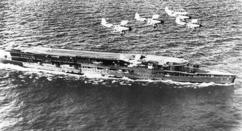 However, it was soon found that a full length flat deck was needed so that wheeled aircraft could have a longer takeoff run and also so that the carrier could steam into the wind during this procedure. Similarly, a through deck – as seen here on HMS Furious in post 1925 condition – allowed aircraft to land free of the turbulence created by air flowing round a conventional superstructure. Another rare design feature of HMS Furious was the second lower flight deck at the forecastle which allowed aircraft to make a 60 feet takeoff run directly from the hangars.