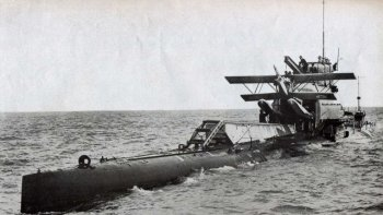 "Of her M Class sister ships M-4 was scrapped while still partly built, M-3 was converted to a mine layer in 1927 and scrapped in 1932, while following the loss of M1 the 12"" gun on M-2 was replaced by a hangar and hydraulic catapult for launching a Gloucestershire-built Parnall Peto biplane - which could be recovered after a reconnaissance flight by a crane. However, M-2 was also lost with all hands, during a training dive on 26 January 1932 and later discovered with her hangar doors open and Parnall Peto N255 - only one of two built - still inside, suggesting that either the hangar doors were opened prematurely or that rear hydroplane failure had caused M-2 to sink at the stern allowing the hangar to flood."