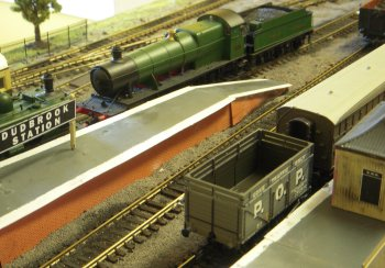Dudbrook was a nine feet long fictitious 00 gauge Great Western Railway layout based in the late 1920s and early 1930s on a double track terminus with four platforms, engine shed and goods sidings. It was 15 year old Andrew's first exhibition layout.