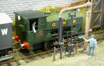 Goonhilly was a small GWR terminus in Cornwall on an imaginary branch from Helston to Goonhilly. The track was by Peco and the structures scratchbuilt or modified from kits. Operation was by a cassette hidden behind the wall next to the locomotive depot.