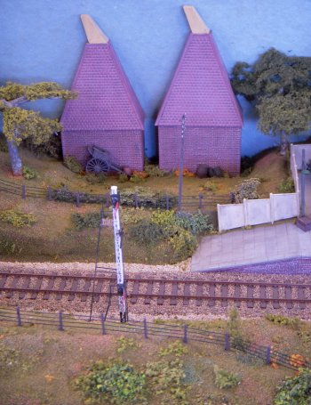 The scenery was based on polystyrene foam, carved to shape and covered with plaster bandage, painted and then overlaid with Woodland scenic ground cover. Motive power consisted of small tank engines and diesels, mostly kit built, of Southern and BR Standard origin, with passenger and goods stock from most of the kit manufacturers.