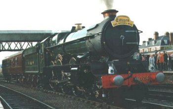 "Preserved Great Western Railway King 4-6-0 6024 ""King Edward I"" rests at Hereford during Pathfinder's Citizen newspaper sponsored Severn Wye railtour during Easter 1993. When the Kings were first built in 1927, the Great Western Railway's publicity department made the most of the new 6000 Class having the highest tractive effort in Britain - 40 300 lb against the 33 500 lb of the Southern Railway's 1926 vintage Lord Nelson class - and the longest non-stop run from London to Plymouth."