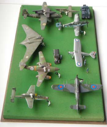 The 1/72 scale display of captured Luftwaffe jet aircraft introduced in 2015 to the Jet Age Museum's model corner was a natural progression from earlier dioramas depicting Gloster built Hawker Typhoon fighter bombers attacking German armoured fighting vehicles and overflying such rocket weapons at the V2 ballistic missile, Bachem Natter and Messerschmitt Me163 Komet. It also offered the possibility of posing a Hawker Typhoon close to its nearest Luftwaffe equivalent, the Focke-Wulf Fw190.