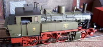 "The Prussian mixed train running alongside The Paris Gun ( really Leopold ) belongs to what German railway modellers refer to as Epoch 1, lasting from the first German steam train – hauled by the British built locomotive ""Der Adler"" between Nuremburg and Fuerth on 7 December 1835 - to 1920 and the creation of Deutsche Reichsbahn Gesellschaft (DRG), the nationalised German railway demanded by the 1919 Treaty of Versailles."