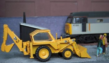 As I like symmetry and needed another yellow vehicle to balance the surveyor's Bedford TK , the Dapol JCB 3 excavator seemed like a good choice - especially as I had often seen the kit for sale but never thought I would need one! However, like so many vehicles I have encountered, the seemingly workaday digger has a secret life of its own as well as a link to Gloucestershire. Although now synonymous with earth moving equipment in the same way that all vacuum cleaners are called Hoovers, J.C. Bamford (Excavators) Limited began in 1945 with just Mr Joseph Cyril Bamford building agricultural trailers and Jeep conversions in a lock-up garage in Uttoxeter, Staffordshire, with a 50 shilling welding machine.