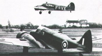 Skyfame's Airspeed Oxford -V3388 - waits for its museum companion - Avro Anson - N4877 coded FVX - to land at Staverton. Note too the Hunting Jet Provost taxiing toward the Oxford's port engine.