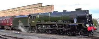 "Built in 1927 by the North British Locomotive Company in Glasgow as London Midland & Scottish Railway number 6115, Royal Scot class 4-6-0 ""Scots Guardsman"" went on to feature in the famous 1936 film ""Night Mail"".  In 1947 it also became the first of its class to be rebuilt with a tapered Type 2A boiler and was the only Royal Scot to operate with smoke deflectors before Nationalisation in 1948.  Withdrawn by British Railways in 1965, it was one of only two class members to be preserved - along with 46100 ""Royal Scot"" - and carried the Olympic Flame in 2012."