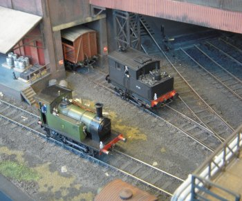 However, The Brewery was also designed for a life beyond the competition as a display arena for a variety of weathered shunters and wagon types, some of which are scratch built. The grain uploading shed and hidden sidings were linked by a space-saving traverser and the main building, loading dock and grain unloading building derived from the Walthers meat packing warehouse kit. The baseboard was built as a single unit with legs that plugged into pockets underneath.