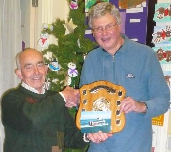 Our December meeting took the now-traditional form of a raffle and buffet following the photographic print competition for The Les Tibbetts Memorial Shield. In 2015 this was won by Branch member Ted Tedaldi with a beautifully lit composition of a Southsea to Ryde hovercraft with a France bound ferry in the background. 2015 also marks 50 years of commercial hovercraft on the Solent. Thanks go to Branch member Keith Reed for organising the competition, Treasurer John Mayer for organising the raffle and to everyone who brought food and prizes.