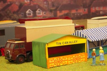 It is always good to catch up with Martin Nash and his splendid 4mm scale fairground featuring such attractions as a Tin Can Alley, Jolly Tube, Wall of Death, Funhouse and Rifle Range and his neighbour for the weekend was Peter Lea with his recently improved and extended lorry depot.