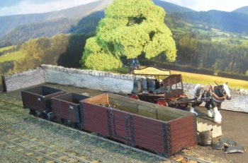 This layout portrayed the two foot narrow gauge railway at Rhyd Ddu, the southern terminus of the North Wales Narrow Gauge Railways' line to Dinas. The station was called Rhyd Ddu until the late 1880's when it took on the name Snowdon, finally in later years it was called South Snowdon. Peter modelled the site as it is thought to have been in the early part of the 20th Century, and was largely based upon photographs and information found in the Welsh Highland Heritage Magazine. The railway was eventually incorporated into the ill fated Welsh Highland Railway in 1922. However it is now the mid point of the new expanding Welsh Highland Railway, which is one of the most impressive narrow gauge railways in the British Isles.