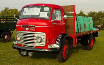 After the two World Wars of the 20th Century however, mature designs of internal combustion road vehicles were being mass produced and roads were being upgraded to serve them. More of the population knew how to drive, and a lorry – such as this 1950s Commer flatbed – could deliver a load direct from a factory to a shop without marshalling, breakage or theft on the way and to places that railway branch lines could not economically serve. In the face of increasing road haulage and many workers shunning coal powered steam traction for cleaner and better paid factory jobs though, the railways still had the advantage of delivering goods by the trainload rather than the lorry load and the possibility of those trains moving faster due to continuous air or vacuum brakes. In an ideal world, freight trains would run at the same speed as passenger workings and share the same tracks rather than having separate slow and fast lines.