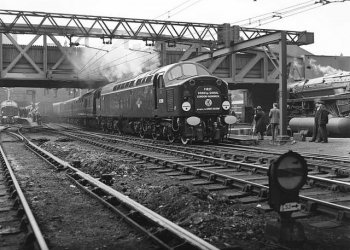 Despite being seen as an experimental hydraulic transmission alternative to English Electric's Class 40 D200, seen here, D600 went into service a month and a day earlier on Monday 17 February 1958. D200 rolled on eight wheeled bogies with three axles powered by separate electric motors inside a non-powered carrying axle. This gave it a wheel arrangement of 1Co-Co1. The bogies of D600 meanwhile each had six wheels, the outer axles being powered on either side of a central carrying axle, thus giving it an A1A-A1A wheel arrangement. Above them, the Glasgow built locomotive had two engines rather than D200s one, which was just as well as on the return inaugural Press run from Bristol one of them failed leaving the other engine, normally running at 1445 rpm, to save the day. In June 1958 sister locomotive D601 became the first diesel to haul the Cornish Riviera Express, marking the start of a catalogue of fine running to the West of England at the decade's end. Despite some 100 mph performances on crack trains the nominally 90 mph D600s were outmoded by Swindon built diesel hydraulics in the 1960s and moved to block oil and other freight trains. D600-D604 were also limited by their Orange Square multiple unit wiring to work only with NBL's later and smaller diesel-hydraulics numbered D6300-D6305.