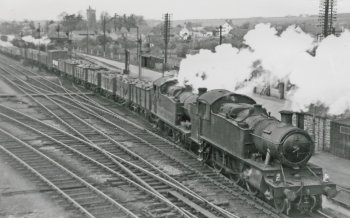 From the Railway Mania of the 1830s, moving freight by rail as opposed to barge or horse drawn cart had been a revelation. Trunk and branch railway lines were being built faster than canals and good quality roads and trains could move faster than their rivals. However, apart from dedicated vehicles moving swiftly together from point to point – such as fish vans between Cornish ports and London – loaded and empty individual wagons required re-marshalling into different trains between producer and consumer. Shunting individual wagons into new trains was a time consuming and labour intensive business which the railways could justify when wages were cheap, workers were plentiful and transport alternatives were slower. Similarly, because the railways were still faster than horses and more widespread than canals, trains of wagons without individual brakes relying on a heavy steam locomotive and brake van to stop them from 30 mph had no real competition for almost a century