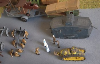 """And that, ladies, is how we captured the Hun tank before you were kind enough to dress our wounds..."" Two brave and ingenious Tommies regale their nurses ( and a uniformed war correspondent, just putting his camera away in its pouch) with the story of acquiring one of only 25 of the A7V sturmpanzerwagen produced."