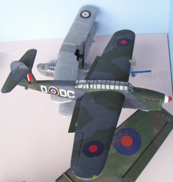 The first all-metal monoplane torpedo bomber of the Fleet Air Arm, the Fairey Barracuda first flew on 7 December 1940 and began entering service in late 1943. Its foldable cantilever shoulder wings incorporating Fairey-Youngman trailing-edge flaps that gave the aircraft a much improved performance capability over its stablemates the Swordfish and Albacore. The fuselage accommodated a crew of three in tandem cockpits, enclosed by a long 'greenhouse' canopy; and housed the main units of the tailwheel landing gear when retracted.