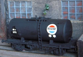 """The model in Mike's collection derived from the famous Airfix / Dapol  20 ton tank wagon - discussed in depth in Gloucestershire's Chemical Romance - was well assembled and only really needed a coat of matt black paint before the application of decals.  But what decals?  Apart from the traditional """"Esso 3300"""" inherited from Airfix - and sold as catalogue CO36 - Dapol in 2011 also offered """"BP 3301"""" [CO34] and """"Regent 375"""" [CO90] of which I had luckily acquired two sets; one decal sheet having already decorated my own spare 20 ton tank wagon for use along the Esso vehicle last seen on Universal Works in Nearly Feltham and pictured here on Capital Works."""