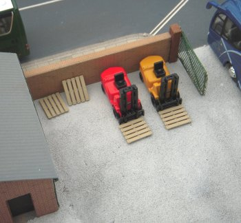 Still in the yard are a pair of B-T models forklift trucks and Gilbow pallets.