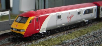 "Also from Chirk came Virgin Train's Mark III DVT (82126), two First Opens (11007 and 11048) and 57 301 ""Scott Tracy"": acquired by way of my good friend Paul Elliot. Matching Trailer Standard Opens numbered 12078 and 12133 were also available separately from Dapol. The majority of Virgin Train's services on the West Coast Main Line are operated by its fleet of 54 nine-car Class 390 Pendolino EMUs but to supplement these services at busy times or to replace failed tilting trains, a set of nine Porterbrook owned Mark III carriages was upgraded to Pendolino standards by Wabtec Rail at Doncaster in July 2009."