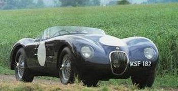 The 1951 vintage C Type, designed specifically with the 24 Hours of Le Mans race in mind, featured a more powerful version of the 3.4 litre 6 cylinder inline XK engine but more radically had a tubular steel chassis - designed by William Heynes - and a normal rear axle connected to a single transverse torsion bar by trailing links and damped by Newton hydraulic shock absorbers. On the off side a reaction member above the axle tube provided rigid placing, taking all the various axle forces and providing excellent road holding. The front suspension was by wishbones and torsion bars in similar units to those used on the XK120.