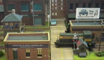 Set in the city of Hereford in West Virginia, Federal street Yard was an urban styled shelf layout designed for switching (shunting to us Limeys!) and was set in a flexible period between 1960s & 1980s. It was DCC controlled with sound fitted locos. Scenic vignettes included a welder and some hobos sitting round a camp fire. Whether any of the boxcars were heading for Bangor, Maine was not recorded!