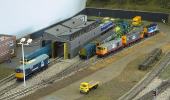 A fictional location in the 1980s and 1990s. The layout includes 5 platforms and a motive power depot with servicing facility. There is a 10-line fiddle yard