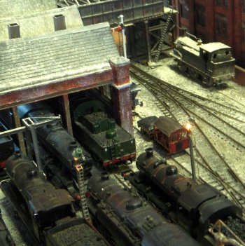 79A is a fictional locomotive depot situated in the North West of England, close to a mainline station, marshalling yard and wagon repair facility sometime in the 1950s.